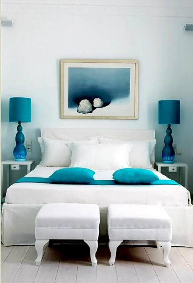 This crisp white room is given life with pops of blue teal color within the accents.